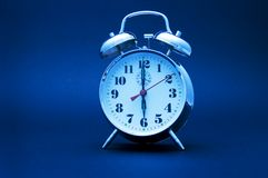 Blue toned clock Stock Photo