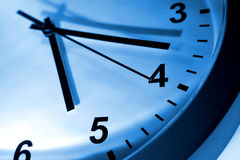 Blue toned clock face. Closeup of blue toned modern clock face Royalty Free Stock Photography
