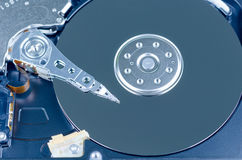Blue toned close up shot of a Harddisk drive. Royalty Free Stock Image
