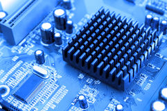 Blue toned  computer motherboard Royalty Free Stock Image