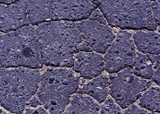 Blue toned damaged asphalt road texture. Royalty Free Stock Photos