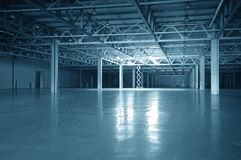 Blue toned empty storehouse Royalty Free Stock Photography