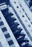 Blue Toned Image of  Modern Architecture background. Blue Toned Image of  Diagonal composition - Modern Architecture background - generic High rise apartment Royalty Free Stock Photo