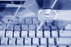 Blue toned keyboard and discs Stock Photo