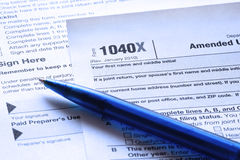 Blue toned pen and U.S. Income tax form Royalty Free Stock Image