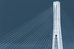 Blue toned photo of cable-stayed bridge Stock Photo