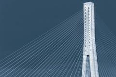 Blue toned photo of cable-stayed bridge Stock Photo