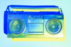 Blue toned picture of retro boombox. On blue background royalty free stock image