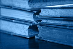 Free Blue Toned Stack Of Old Vintage Hardcover Books Royalty Free Stock Photos - 166085218