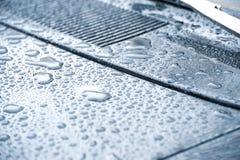 Blue toned raindrops Stock Photos