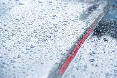 Blue toned vehicle raindrops. Blue toned vehicle raindrop abstract stock image