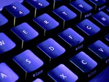 Blue tones keyboard closeup royalty free stock photos