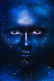 Blue tones portrait of cute woman with dark face art Royalty Free Stock Images