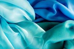 Blue tones of silk fabric stock image