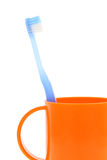 Blue toothbrush and cup Stock Images
