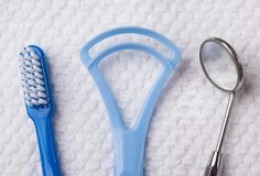 Blue toothbrush with dental tools Stock Photo