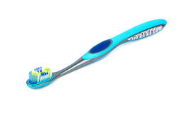Blue toothbrush. New blue toothbrush isolated on white background stock photo