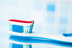 Blue toothbrush with red stripe toothpaste Royalty Free Stock Photography