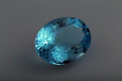 Blue topaz. Close faceted blue topaz oval Stock Photography