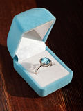 Blue topaz engagement ring. In a gift box Royalty Free Stock Photos