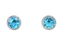 Blue topaz Gemstone and diamond earrings cushion cut with a halo setting. Stock Image
