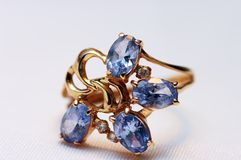 Blue topaz on golden rings Stock Photography