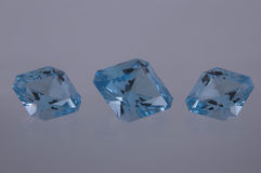 Blue topaz. Set of three faceted blue topaz Royalty Free Stock Image