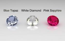Blue topaz, white diamond and pink sapphire stones Stock Photos