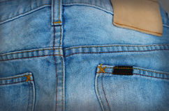 Blue torn denim jeans background Royalty Free Stock Photography