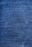Blue torn denim jeans texture Royalty Free Stock Photography