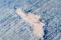 Blue torn denim jeans texture Stock Image
