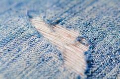 Blue torn denim jeans texture Stock Image