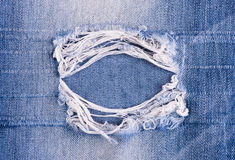 Blue torn denim jeans texture. For you design Royalty Free Stock Photo