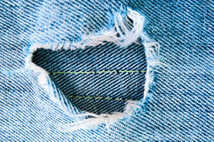 Blue torn jeans Stock Photo