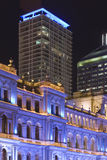 Blue tourist site brisbane portrait 2. Old building glowing at night with sky scrapers behing it in brisbane Stock Images