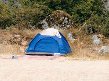 Blue tourist tent standing on the sandy beach Stock Photo