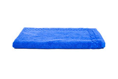 Blue towel. Blue shower, a towel on a white background. Studio photography Royalty Free Stock Photos