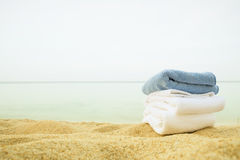Blue towel on the beach in a sunset Royalty Free Stock Photography