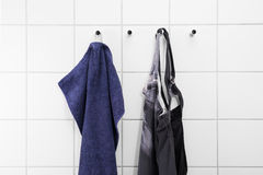 Blue towel and a black swimsuit Stock Images