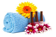Blue towel, nail polish, gerbera Stock Photos