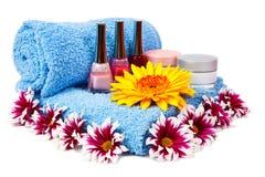 Blue towel, nail polish, gerbera Stock Photography