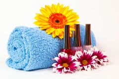 Blue towel, nail polish, gerbera Stock Photo