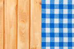 Blue towel over wooden kitchen table Stock Image
