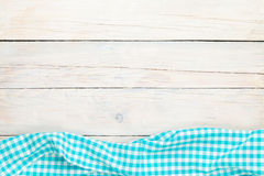 Blue towel over wooden kitchen table Stock Images