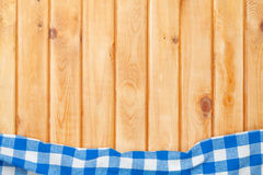 Blue towel over wooden kitchen table Royalty Free Stock Photos