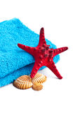 Blue towel with red starfish Stock Photos