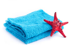 Blue towel with red starfish Royalty Free Stock Photo