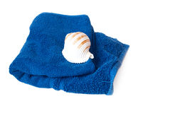 Blue towel and seashell. Isolated on white background Royalty Free Stock Photos