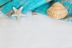 Blue towel starfish and shells on white background Stock Photo