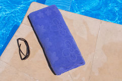 Blue towel and sunglasses Royalty Free Stock Photo